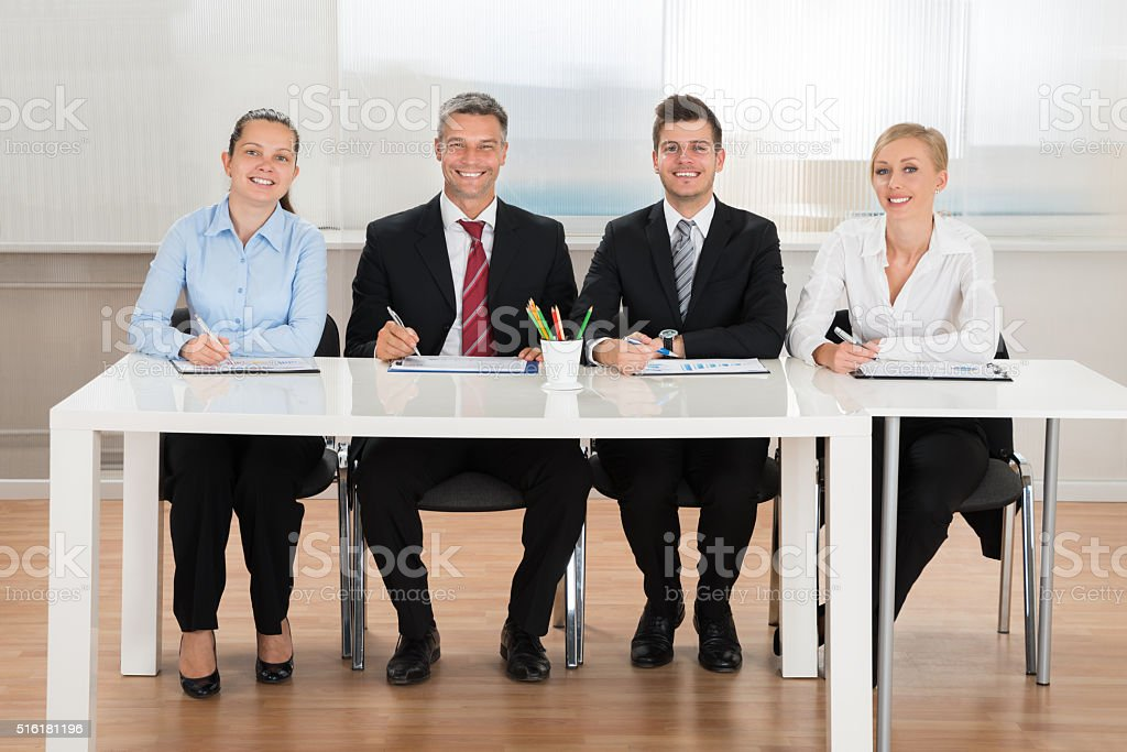 Happy Businesspeople Analyzing Graph stock photo