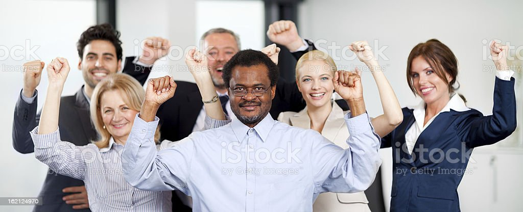 Happy  businesspeople celebrating success royalty-free stock photo