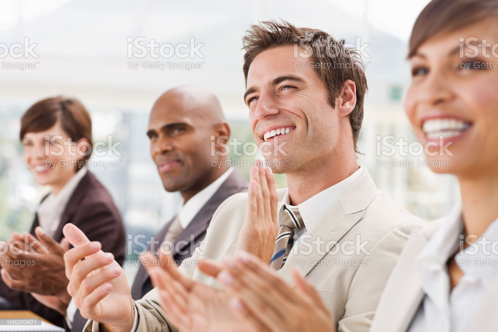Happy businesspeople clapping hands royalty-free stock photo