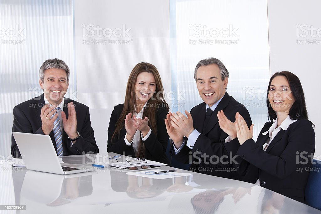 Happy Businesspeople Clapping stock photo