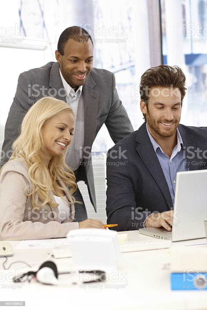 Happy businesspeople working together royalty-free stock photo