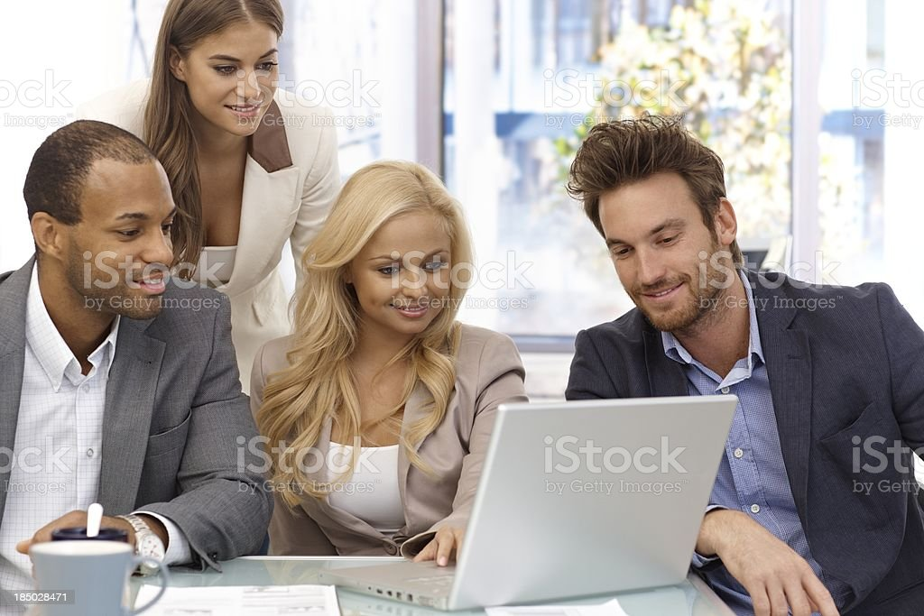 Happy businessteam working with laptop computer royalty-free stock photo