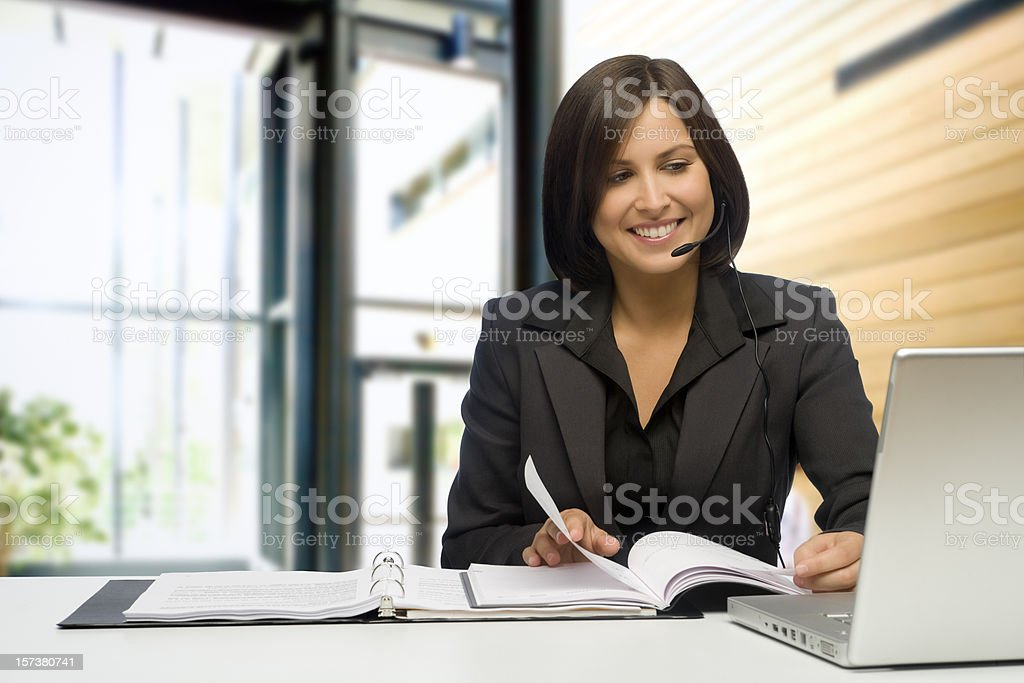 Happy Businesswoman At The Office stock photo