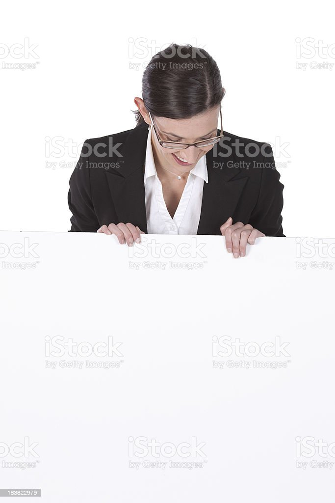 Happy businesswoman bahind a placard royalty-free stock photo