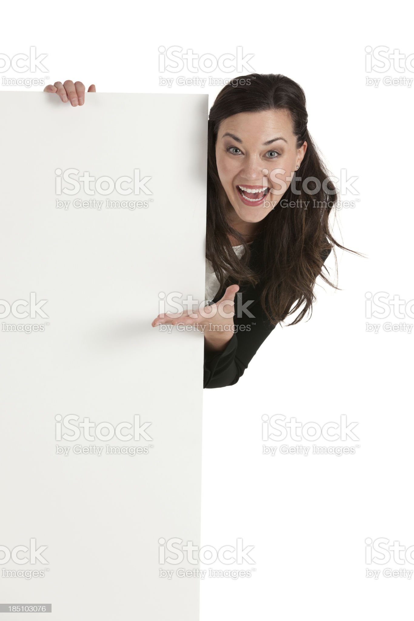 Happy businesswoman behind a placard royalty-free stock photo