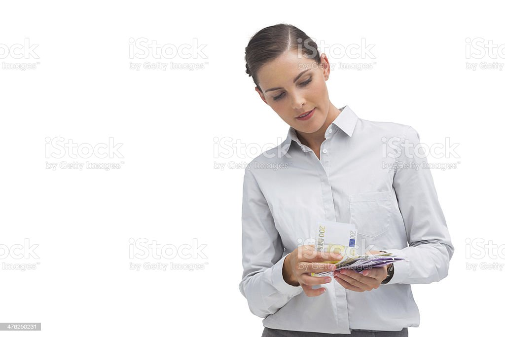 Happy businesswoman counting money royalty-free stock photo