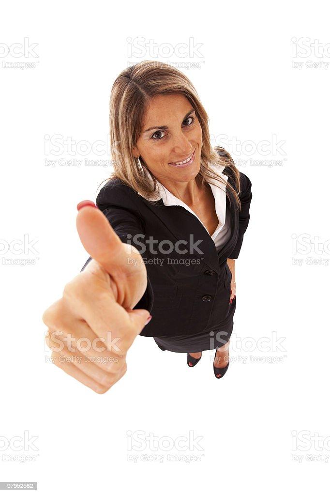 Happy businesswoman gesturing OK royalty-free stock photo
