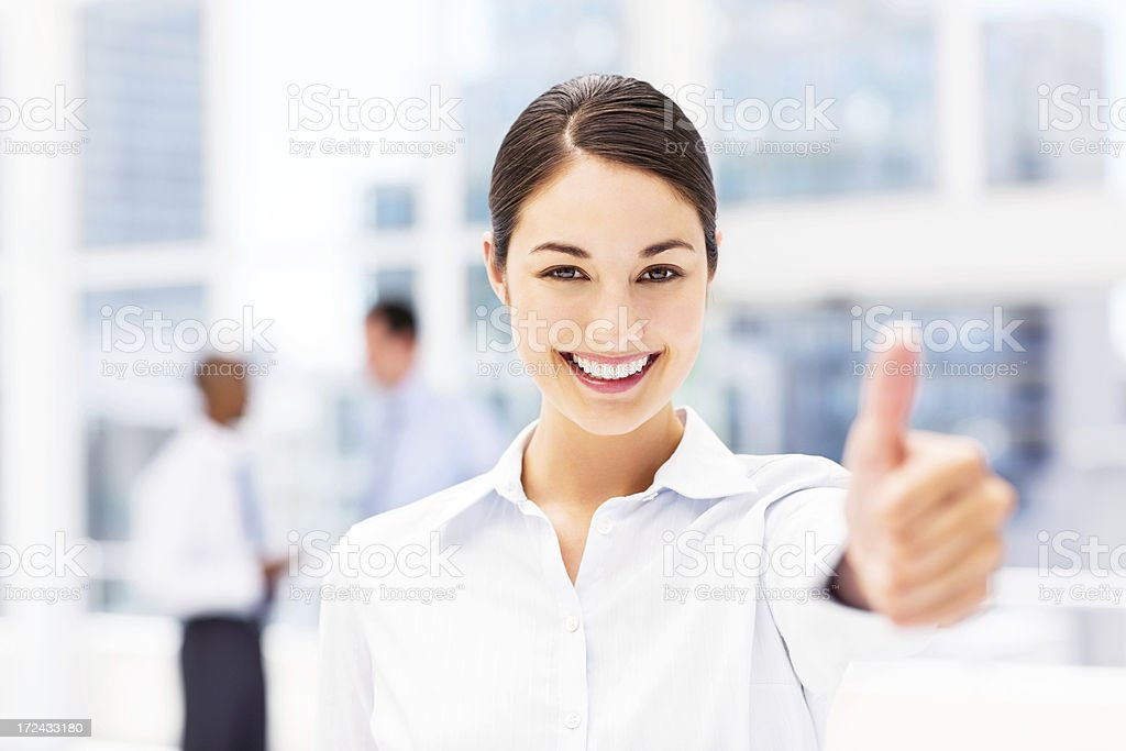 Happy Businesswoman Giving Thumbs Up royalty-free stock photo