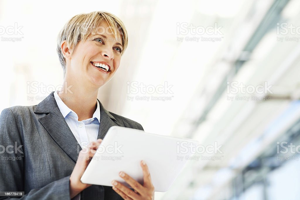 Happy Businesswoman Holding Digital Tablet royalty-free stock photo