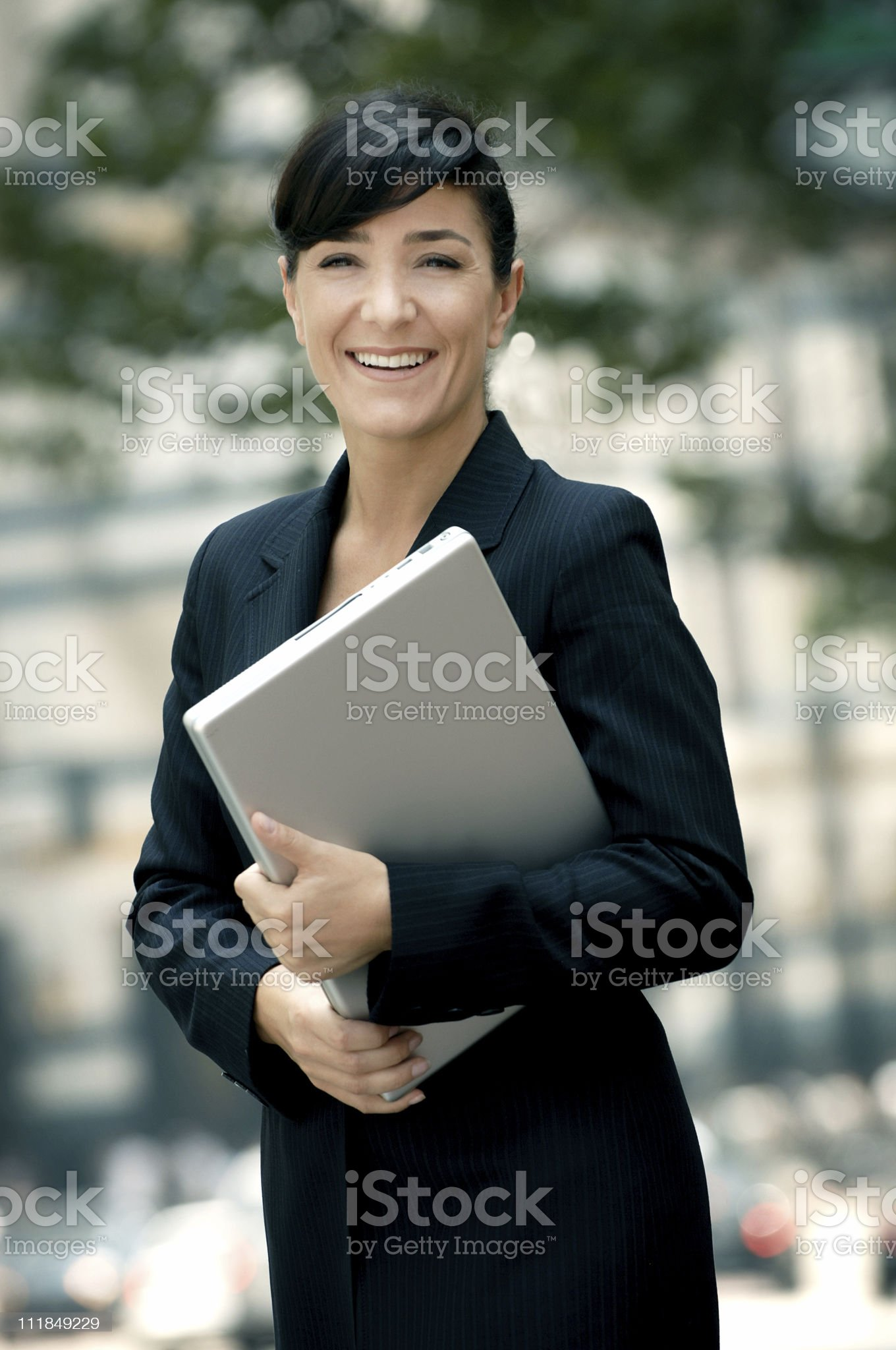 Happy Businesswoman holding Laptop computer royalty-free stock photo