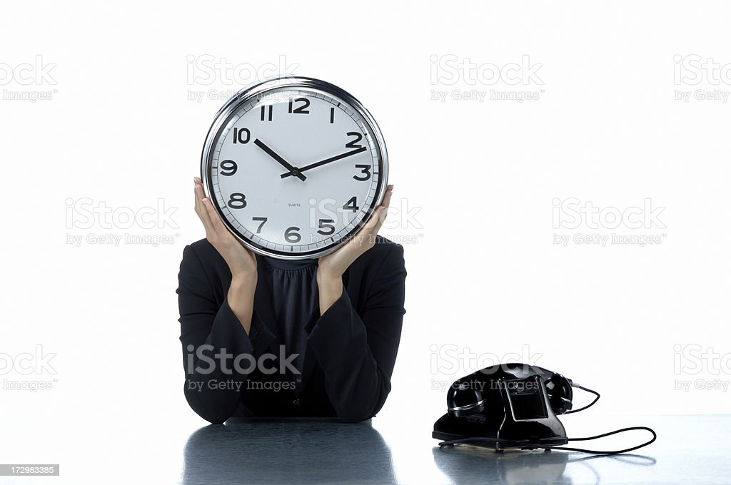 happy businesswoman holding office clock royalty-free stock photo