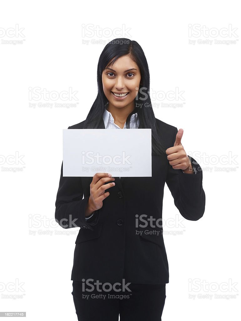 Happy businesswoman holding placard and showing thumbs up sign royalty-free stock photo