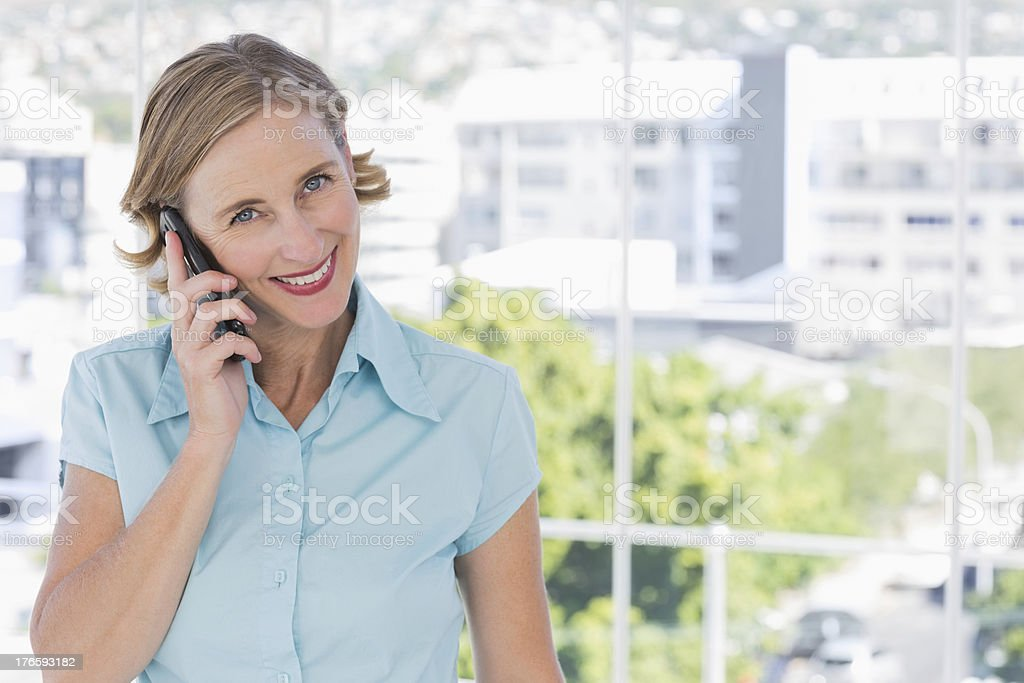 Happy businesswoman holding smartphone royalty-free stock photo