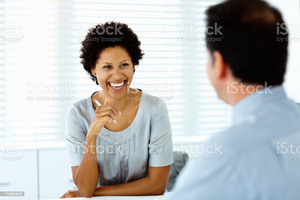 Happy businesswoman in a meeting with her colleague royalty-free stock photo