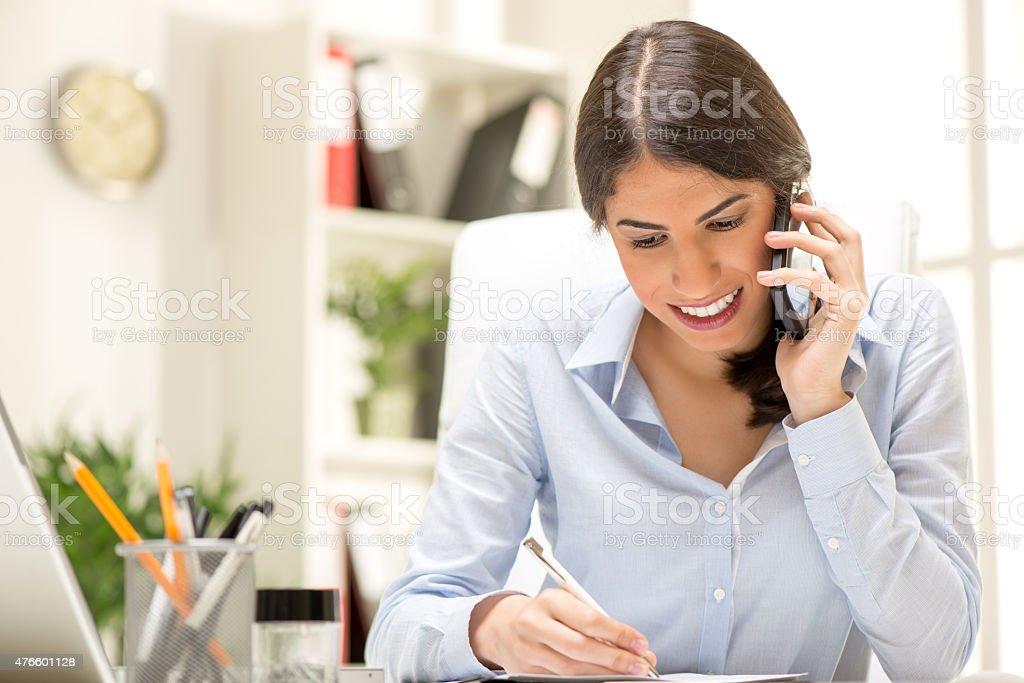 Happy Businesswoman Phoning stock photo