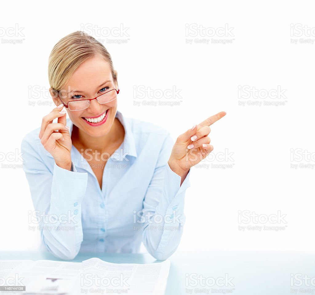 Happy businesswoman pointing at copy space royalty-free stock photo