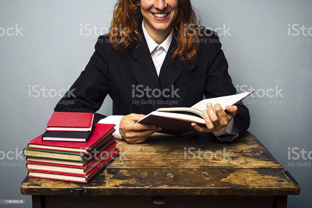 Happy businesswoman reading royalty-free stock photo