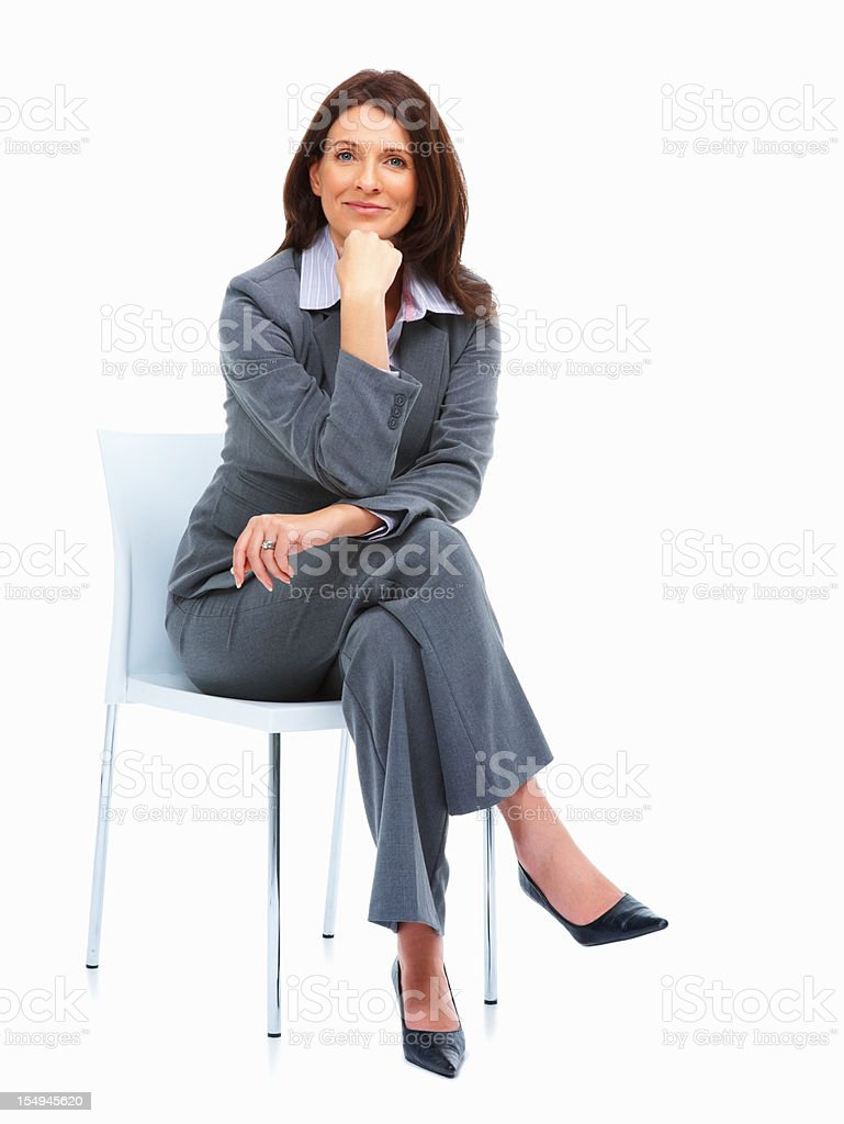 Happy businesswoman sitting on a chair royalty-free stock photo