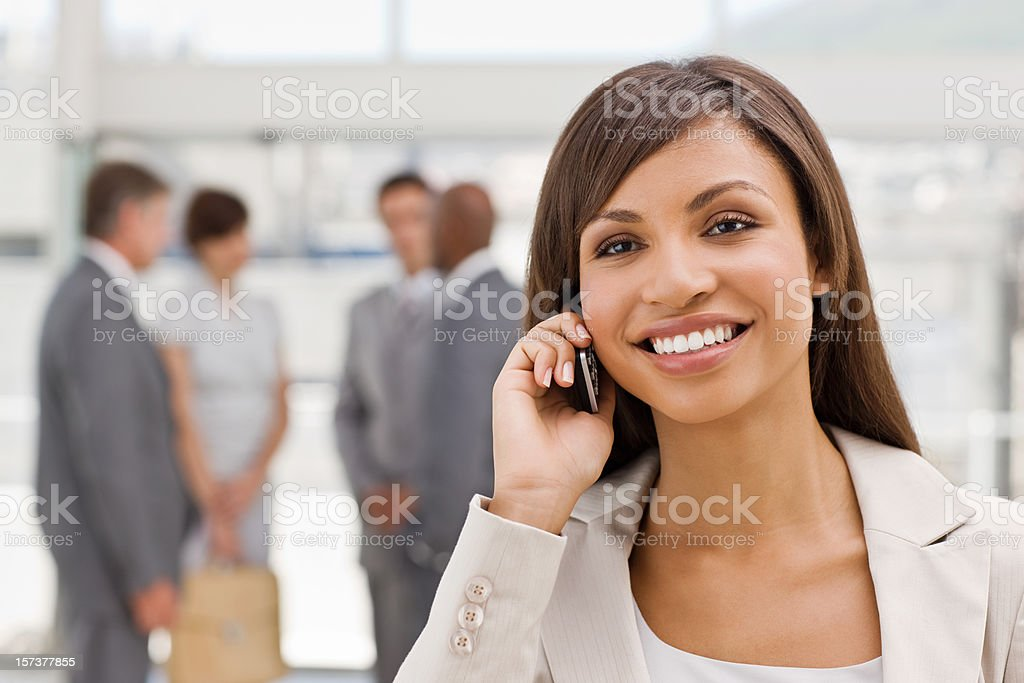 Happy businesswoman talking on mobile phone royalty-free stock photo