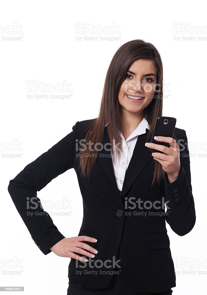 Happy businesswoman using smart phone royalty-free stock photo
