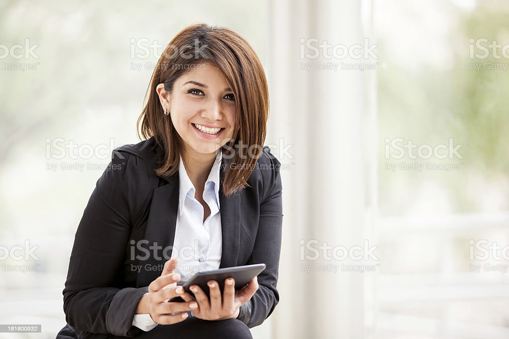 Happy businesswoman with a tablet stock photo
