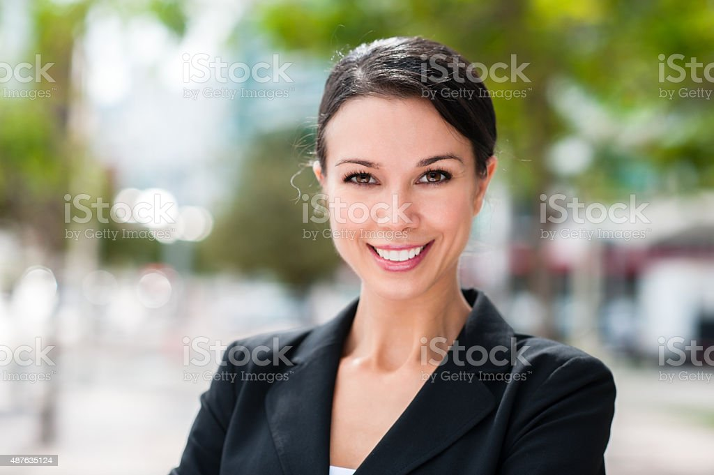 Happy Businesswoman with Arms Crossed stock photo
