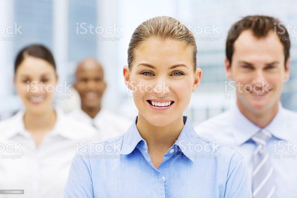 Happy Businesswoman With Associates royalty-free stock photo