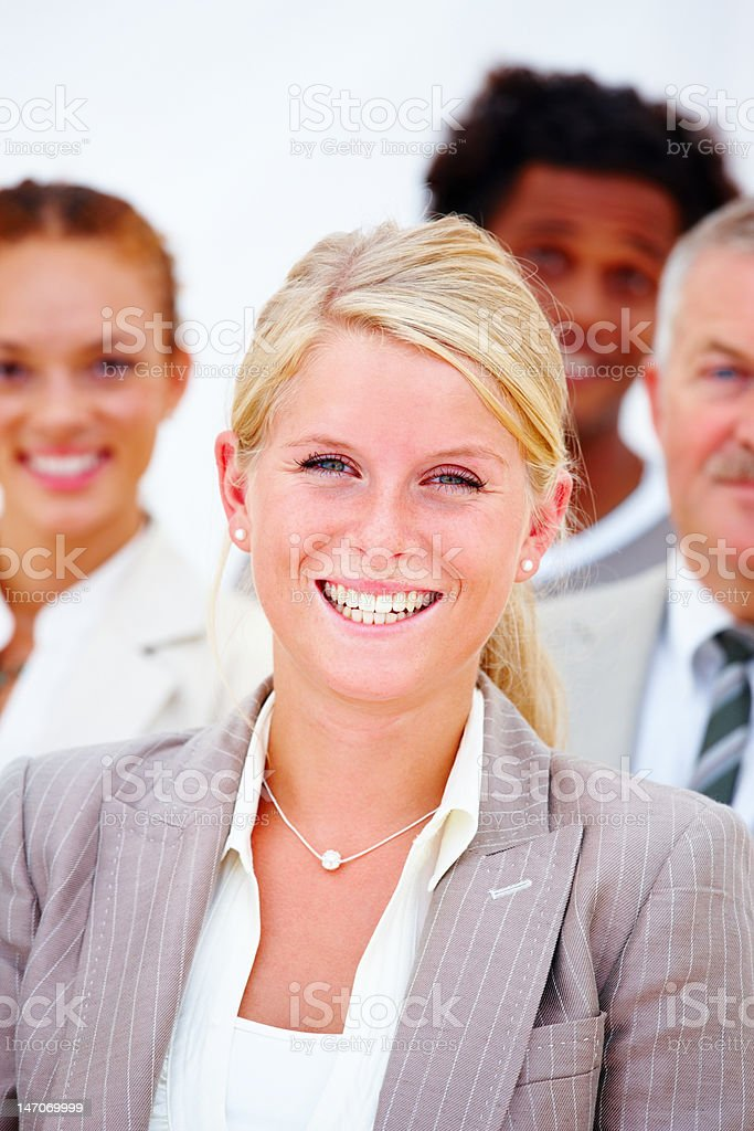 Happy businesswoman with her colleagues against white background royalty-free stock photo
