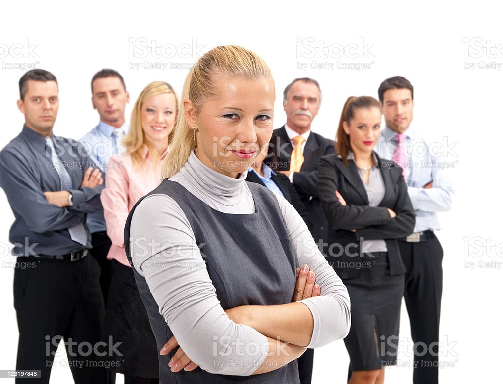 Happy businesswoman with her team in the background royalty-free stock photo