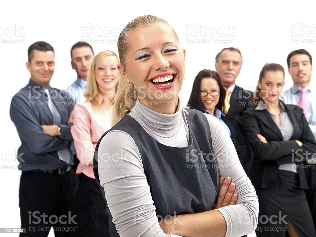 Happy businesswoman with her team in the background. royalty-free stock photo