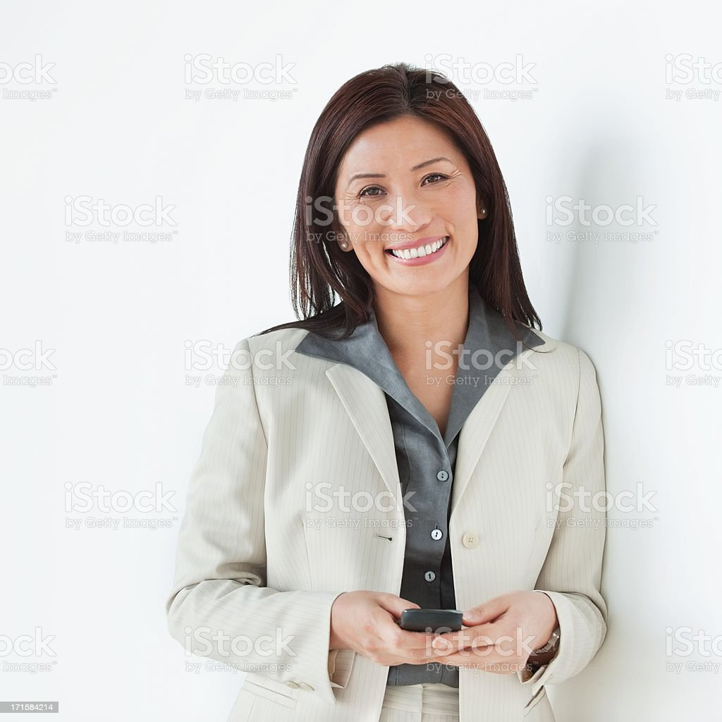 Happy Businesswoman With Mobile Phone - Isolated. royalty-free stock photo
