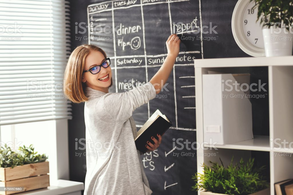 Happy businesswoman woman at school board with schedule planning stock photo