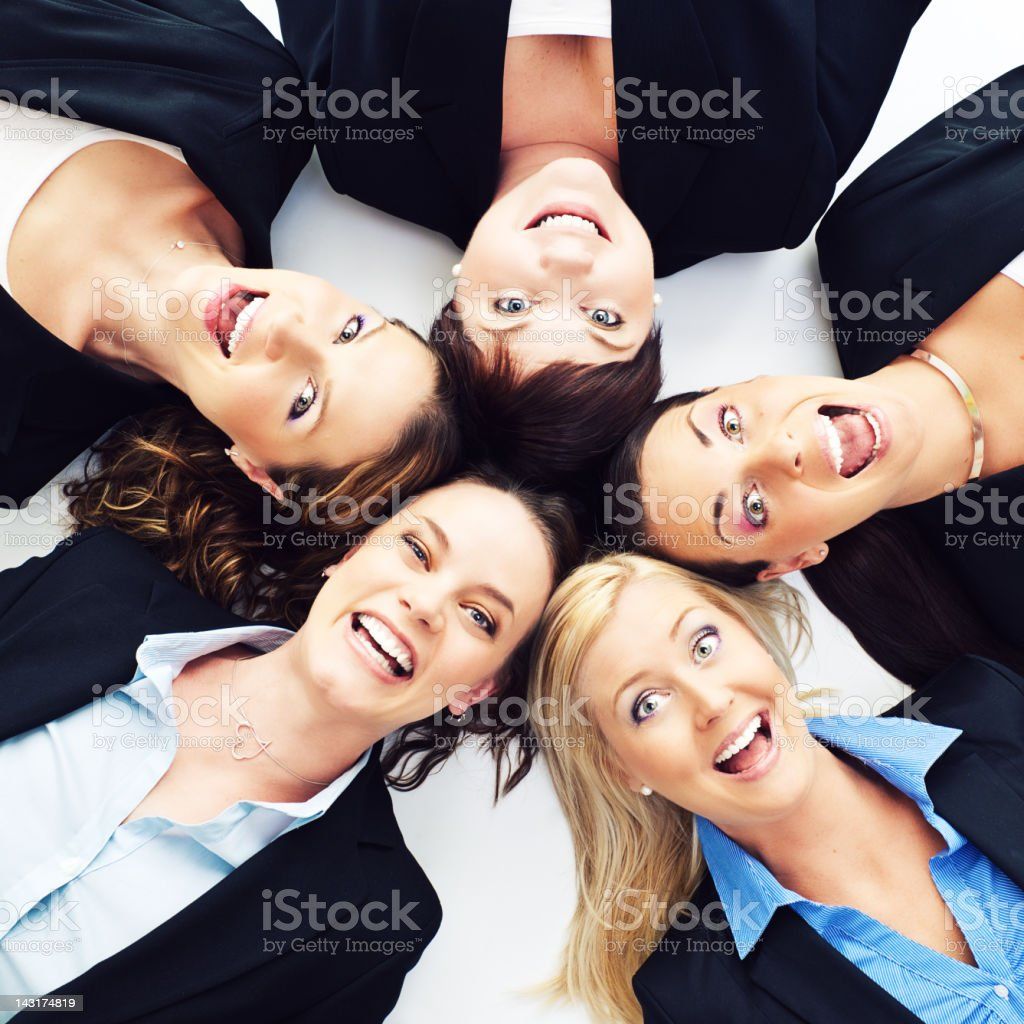 Happy businesswomen lying in a formation royalty-free stock photo