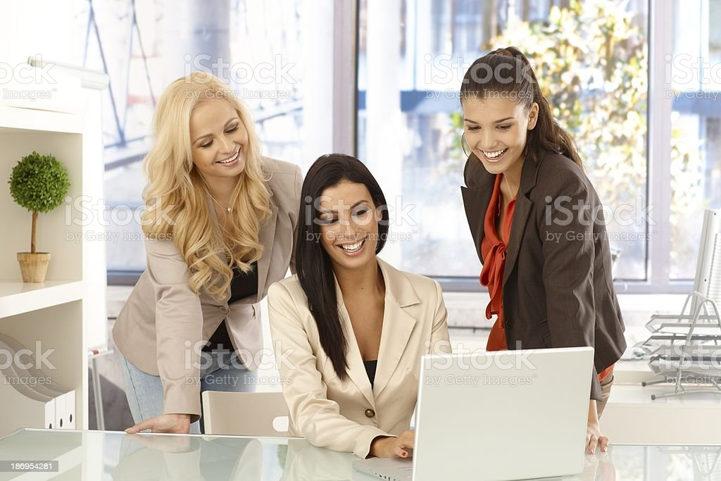 Happy businesswomen working together at office royalty-free stock photo