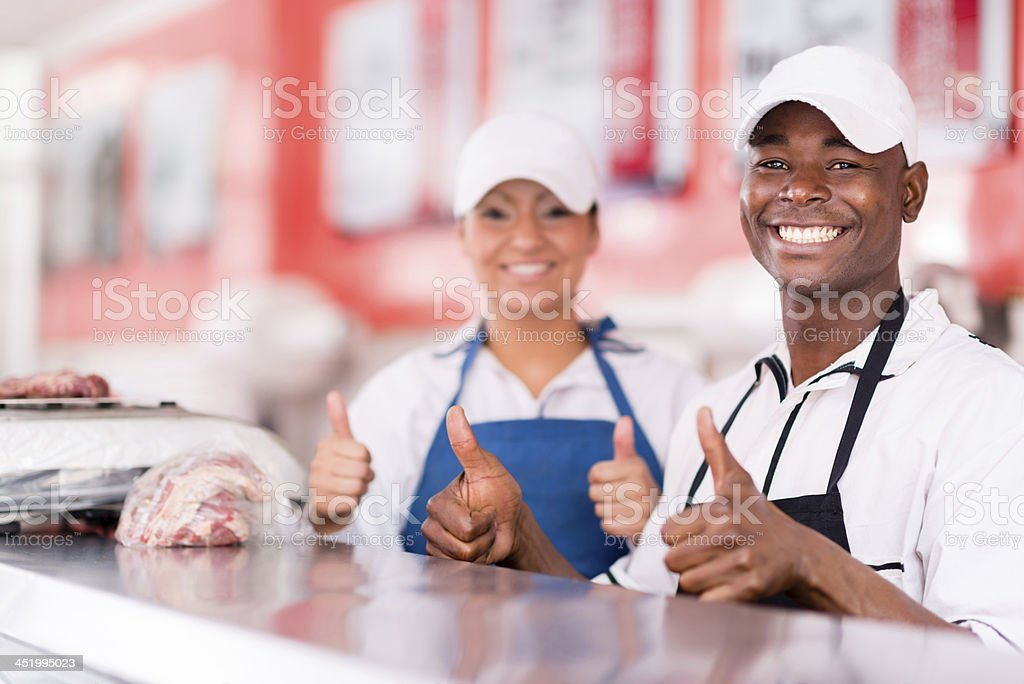 Happy butchers shop owners royalty-free stock photo