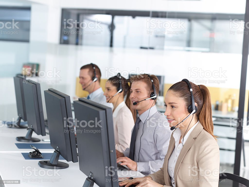 Happy call center operators stock photo