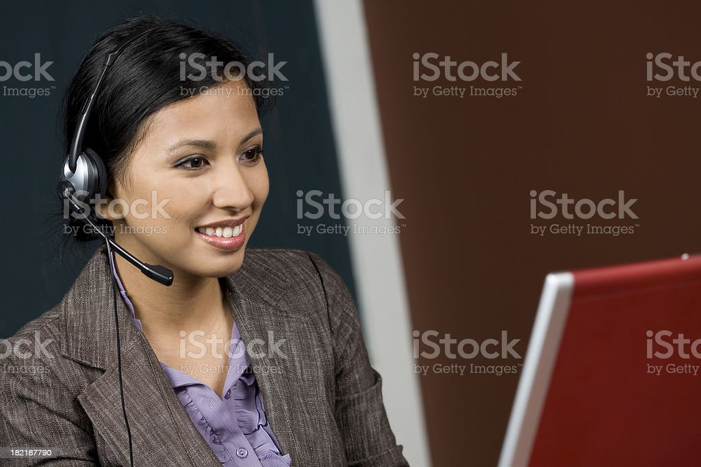 Happy Call Center Worker Looking at Her Computer royalty-free stock photo