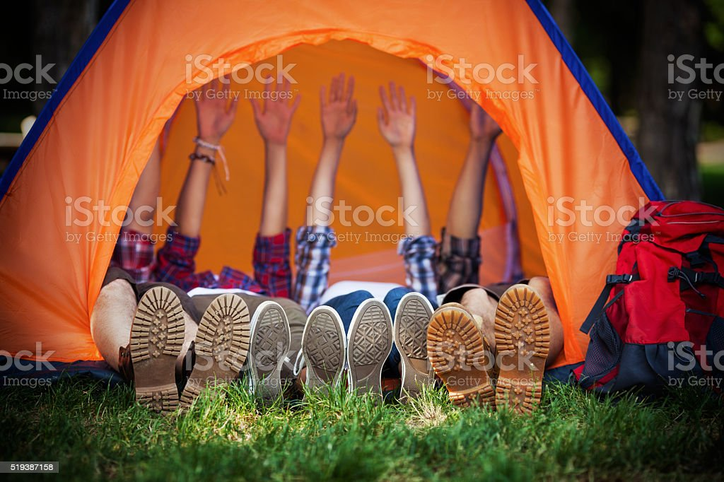Happy Campers Lying in a Tent stock photo
