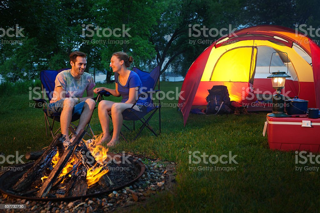 Happy Campers Roasting Marchmallows in Campground Horizontal stock photo