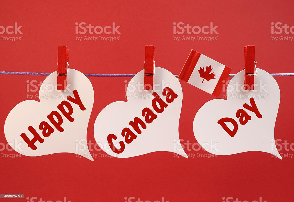 Happy Canada Day message hanging from pegs on a line stock photo