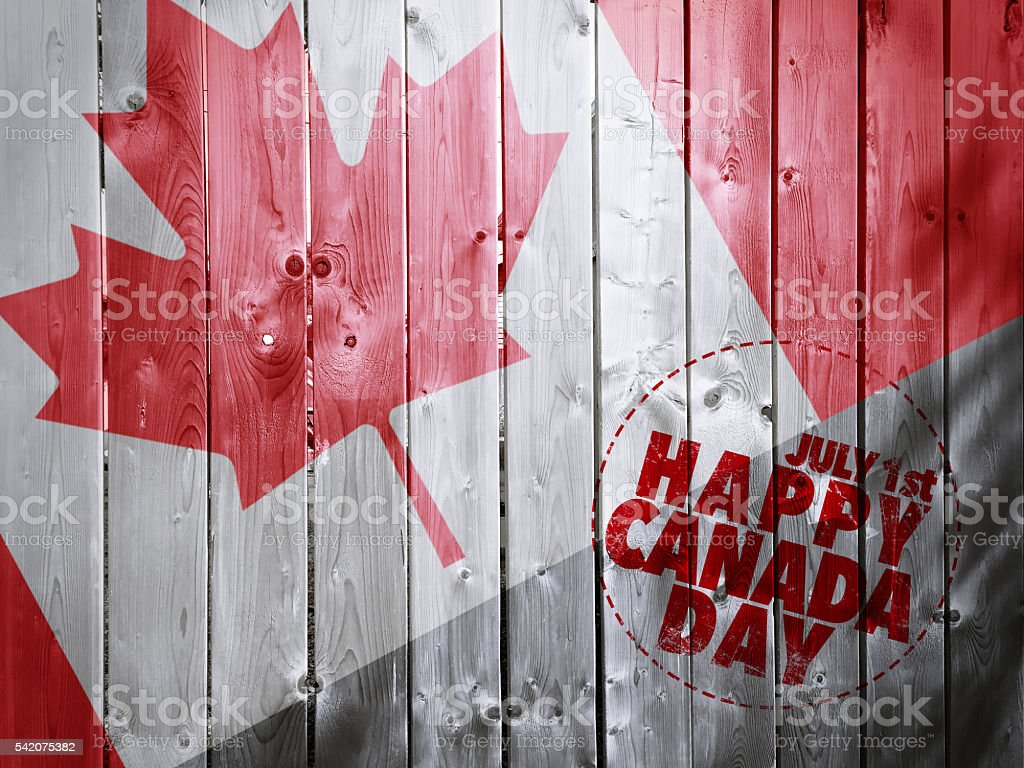 Happy Canada day on Wooden fence texture background stock photo