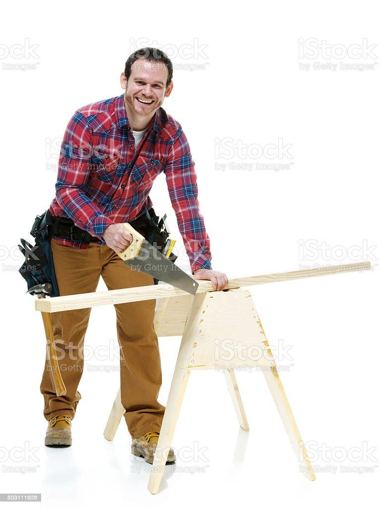 Happy carpenter working stock photo