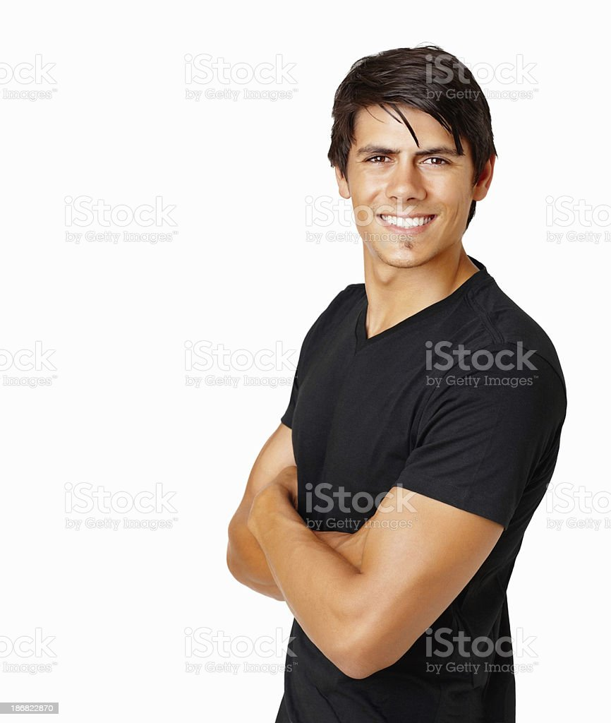 Happy casual guy with hands folded against white royalty-free stock photo