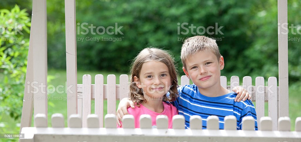 Happy Cauacsian Children Playing on Swing stock photo
