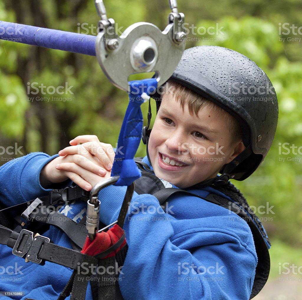 Happy Caucasian Boy Ziplining royalty-free stock photo