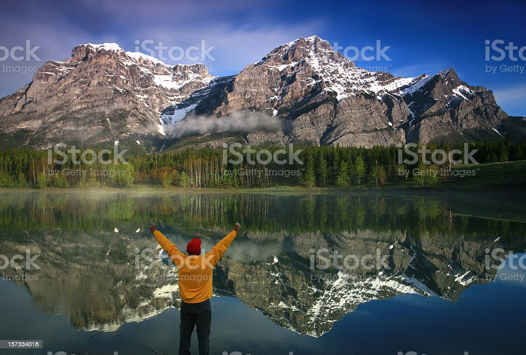 Happy Caucasian Middle Aged Man in the Mountains stock photo