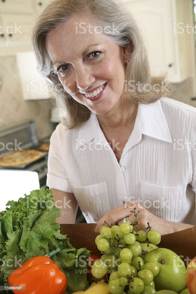 Happy Caucasian Senior Adult with Her Bags of Groceries royalty-free stock photo
