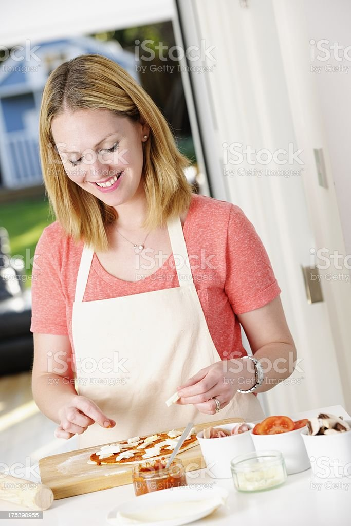 Happy Caucasian Woman Preparing Pizza royalty-free stock photo