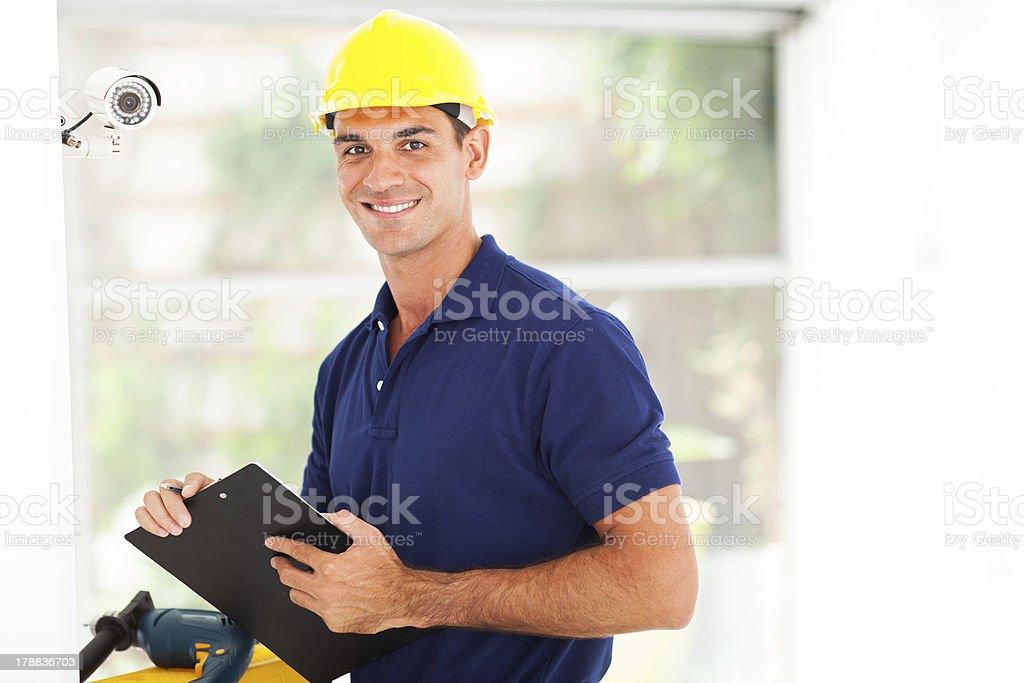 happy cctv camera technician stock photo