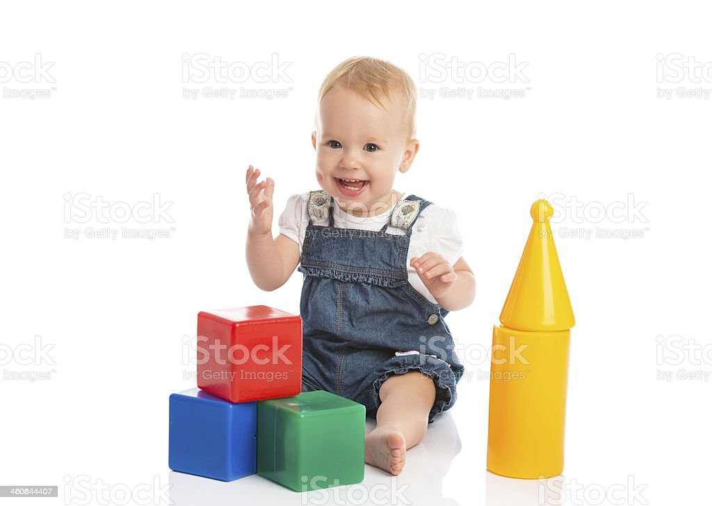 happy cheerful child playing with blocks cubes isolated on white stock photo
